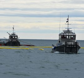 Spill Response Team practicing nearshore recovery Tactic R-20 U-Boom with Open Apex to Skimming System.