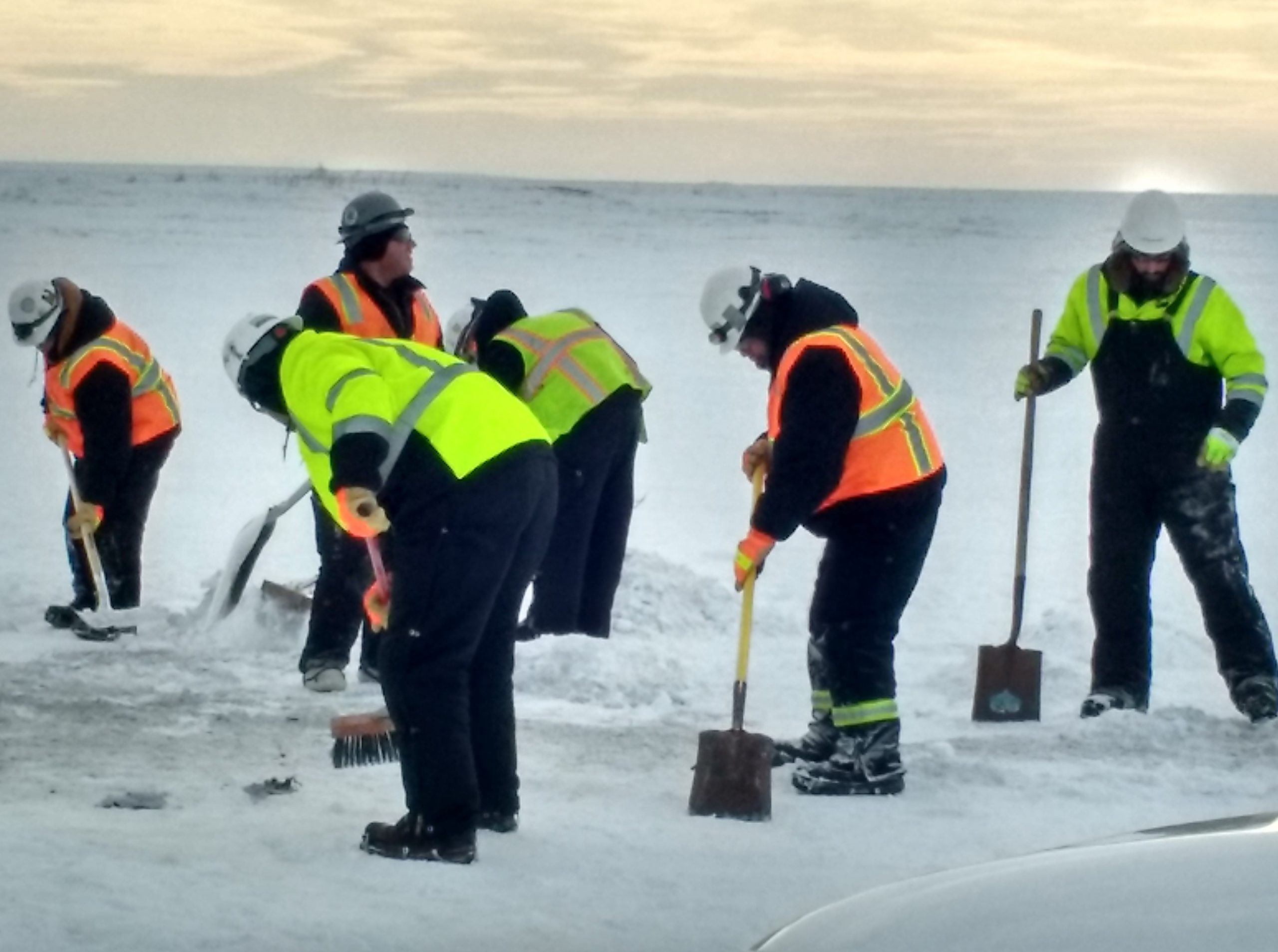 Spill Response Team members clean up residual material following a remote equipment fire